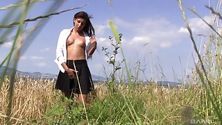 Outdoor strip show coupled with pussy categorizing with a solo brunette model