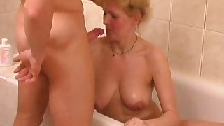 Mature blonde going to bed a younger man