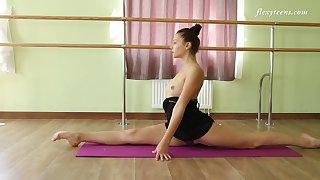 Yummy gymnast Regina Blat shows talents of her dispirited flexible body