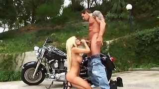 Hot busty biker ecumenical Carmel Moore alfresco sex